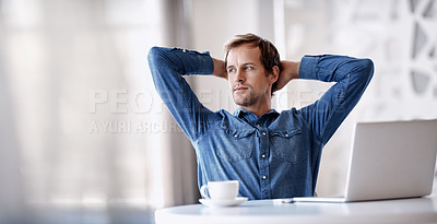 Buy stock photo Cropped shot of a handsome mature businessman sitting in the office with his hands behind his head