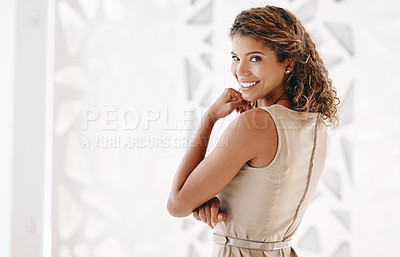 Buy stock photo Cropped portrait of an attractive young businesswoman standing in the office with her hand on her chin
