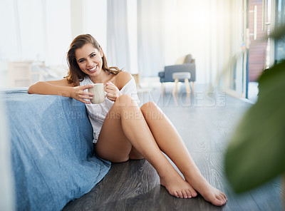 Buy stock photo Full length shot of a beautiful young woman enjoying a cup of coffee while relaxing in her bedroom at home