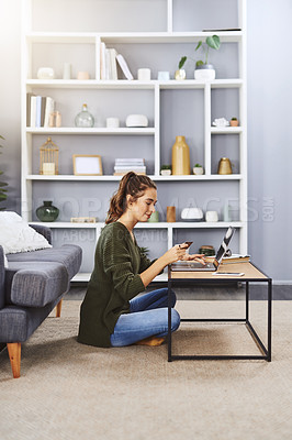 Buy stock photo Full length shot of a young woman using a laptop and credit card to do some online shopping at home