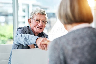 Buy stock photo Shot of a senior doctor shaking hands with a patient during a consultation in his office