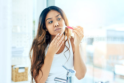 Buy stock photo Cropped shot of a beautiful young woman shaving her facial hair at home