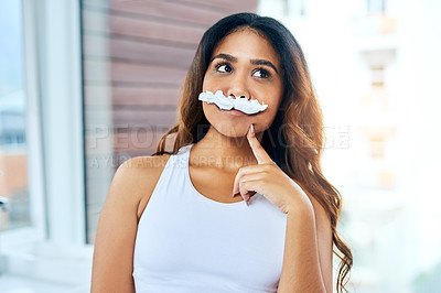 Buy stock photo Cropped shot of a young woman posing with a fake mustache made from shaving cream