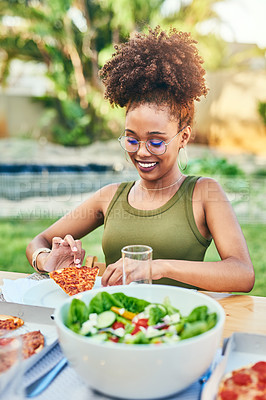 Buy stock photo Cropped shot of a cheerful young woman about to eat a slice of pizza at a dinner party outside in the afternoon