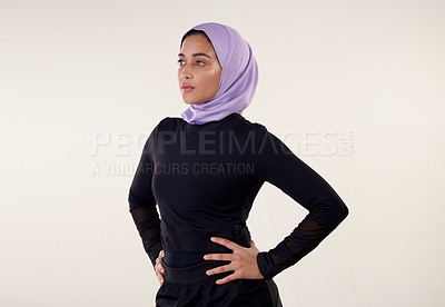 Buy stock photo Cropped shot of an attractive young woman wearing a headscarf against a beige background on the studio