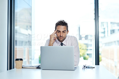 Buy stock photo Cropped shot of a businessman sitting with his laptop in his office