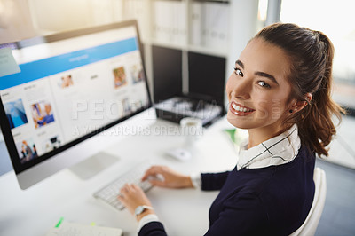 Buy stock photo Portrait of an attractive young businesswoman sitting at her desk and using her computer in a modern office