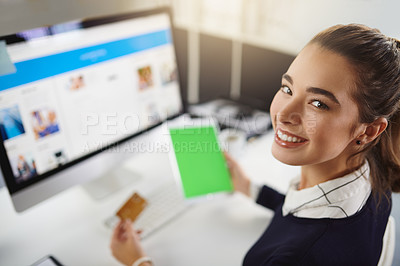 Buy stock photo Portrait of an attractive young businesswoman holding a bank card and a tablet in a modern office