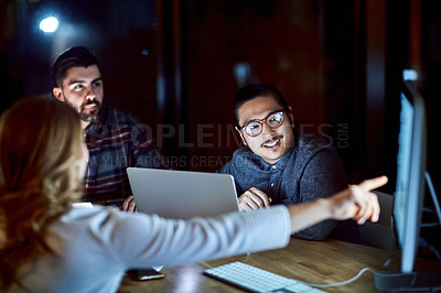 Buy stock photo Shot of a group of young businesspeople having a meeting during a late night at work