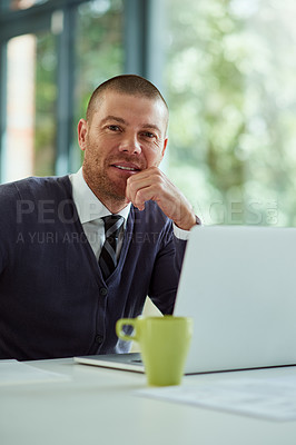 Buy stock photo Portrait of a handsome middle aged  businessman working on a laptop in his office