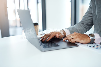 Buy stock photo Cropped shot of an unrecognizable businessman using a laptop