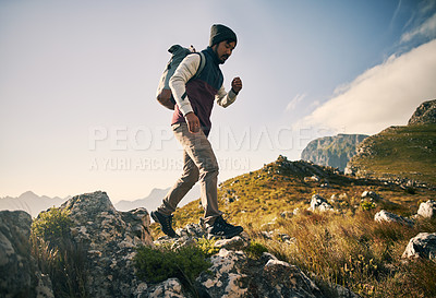 Buy stock photo Shot of young people in the mountains