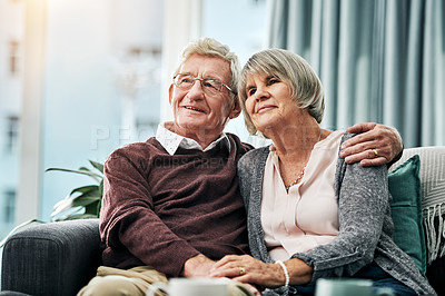 Buy stock photo Shot of a happy elderly couple relaxing together on the sofa at home
