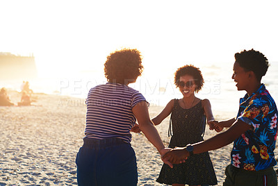 Buy stock photo Cropped shot of an attractive young trio of women enjoying a day out together on the beach during the day