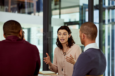 Buy stock photo Shot of a group of businesspeople having a meeting in their office boardroom