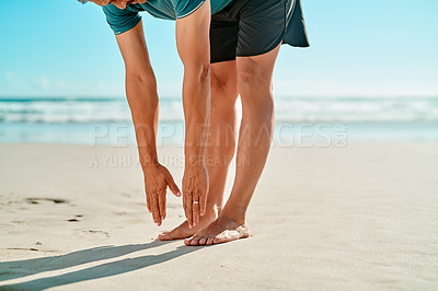 Buy stock photo Cropped shot of an unrecognizable senior man standing and stretching on the beach during the day