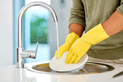 Buy stock photo Cropped shot of an unrecognizable woman washing dishes at home