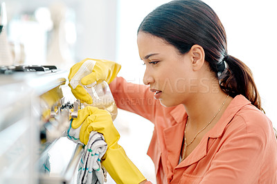 Buy stock photo Cropped shot of a beautiful young woman cleaning her house