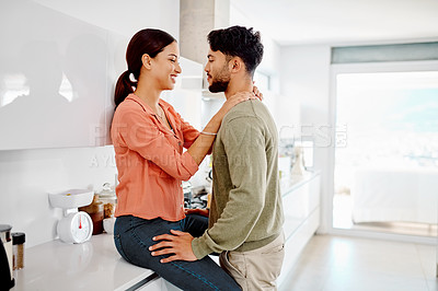 Buy stock photo Cropped shot of an affectionate couple in their kitchen