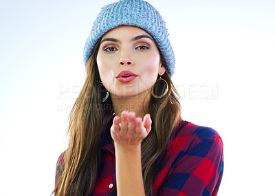 Buy stock photo Cropped shot of a beautiful young woman blowing kisses against a white background