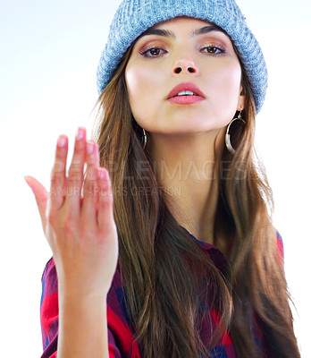 Buy stock photo Cropped shot of a young woman posing against a white background