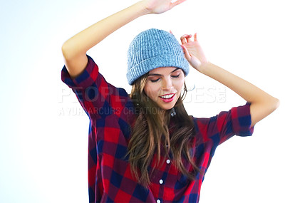 Buy stock photo Cropped shot of a young woman dancing against a white background