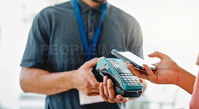 Buy stock photo Cropped shot of an unrecognizable young delivery man receiving payment from a female customer for her order