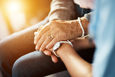 Buy stock photo Cropped shot of a nurse holding hands with a senior woman