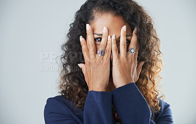 Buy stock photo Cropped shot of a playful mature woman placing her hands over her face while standing against a gray background