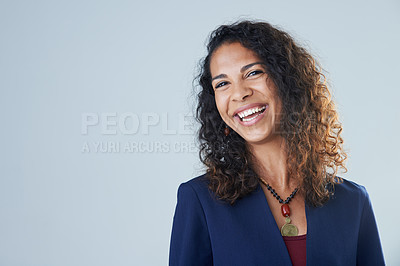 Buy stock photo Cropped portrait of an attractive mature woman standing and laughing against a gray background in the studio