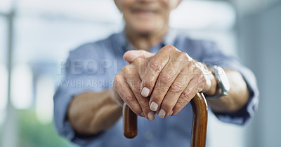 Buy stock photo Cropped shot of an unrecognizable senior man holding on to his walking cane