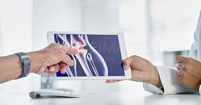 Buy stock photo Cropped shot of a senior patient showing his doctor something on a digital tablet
