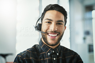 Buy stock photo Portrait of a cheerful young businessman wearing a headset in his office
