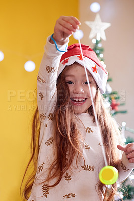 Buy stock photo Shot of a little girl playing a yoyo on Christmas day