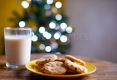 Buy stock photo Shot of cookies and milk on a table on Christmas eve