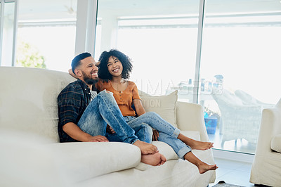 Buy stock photo Shot of a happy young couple spending quality time together at home