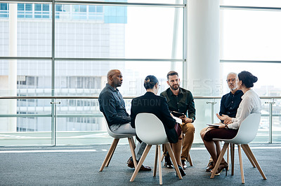 Buy stock photo Full length shot of a group of businesspeople during a meeting at work