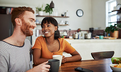 Buy stock photo Cropped shot of a young couple enjoying coffee at home