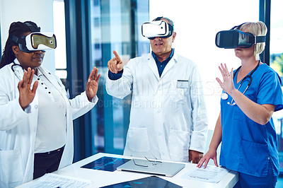 Buy stock photo Cropped shot of three medical practitioners wearing vr headsets during a meeting in their boardroom