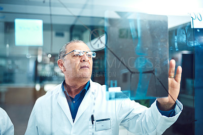 Buy stock photo Cropped shot of a male medical practitioner working on a glass wipe board in the hospital