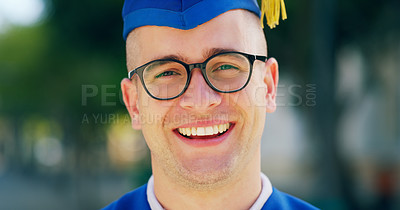 Buy stock photo Cropped portrait of a handsome young man smiling at the camera while being outside during the day