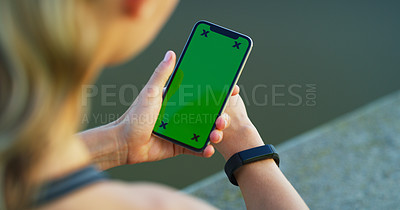 Buy stock photo Shot of a woman linking her smartwatch to her cellphone