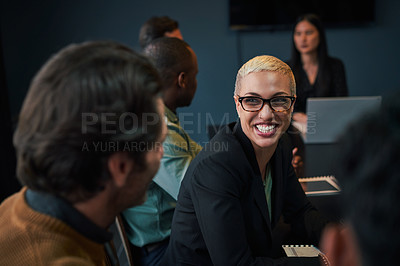 Buy stock photo Cropped shot of a group of young businesspeople sitting and talking with each other while in the office