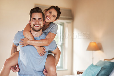 Buy stock photo Portrait of a playful young couple spending some quality time together in their bedroom