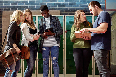 Buy stock photo Shot of a group of young men and women hanging out together by the lockers at university