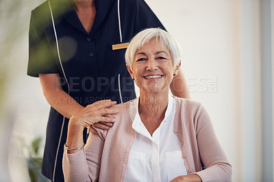 Buy stock photo Cropped shot of an unrecognizable young female nurse caring for a senior woman sitting in a wheelchair in a nursing home