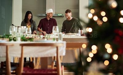 Buy stock photo Shot of two young men cooking a Christmas meal at home