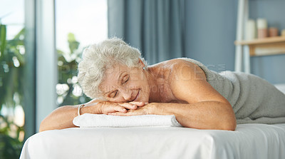 Buy stock photo Cropped shot of a relaxed senior woman lying down on a massage bed before her massage during the day