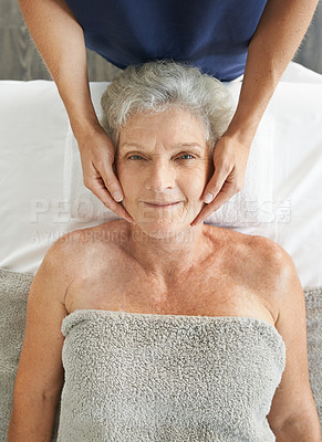 Buy stock photo Cropped portrait of a relaxed senior woman enjoying a head massage at the spa during the day