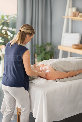 Buy stock photo Cropped shot of a relaxed senior woman enjoying a shoulder massage at the spa during the day